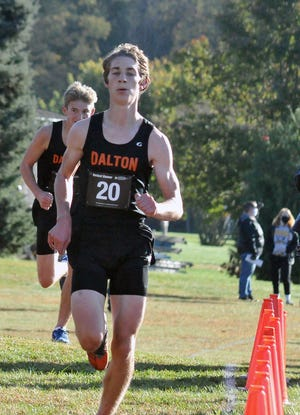 Dalton's Mitchell Kutz (front) and Evan Hodkinson finished second and third in the boys division to lead the 'Dawgs to a team title.