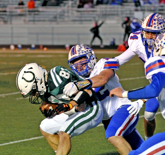 West Holmes' Lane Graham brings down Cloverleaf's Kodey Trent during their Division III playoff game this season.