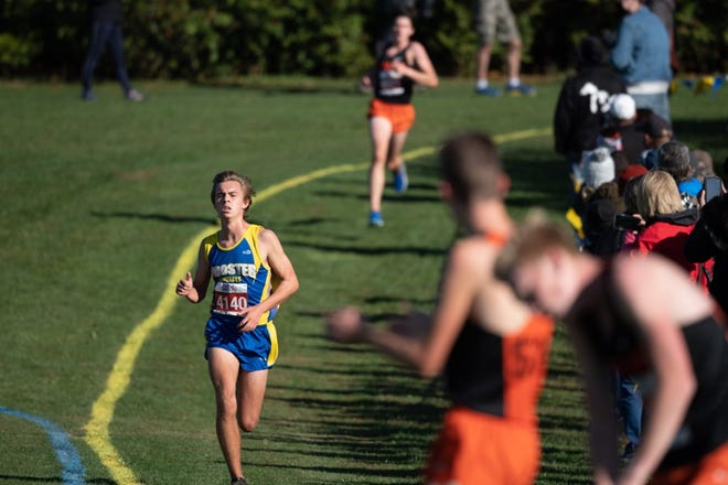 Wooster's Ashton Dunlap nears the finish line during the 2020 OCC Championships held at Wooster High School.