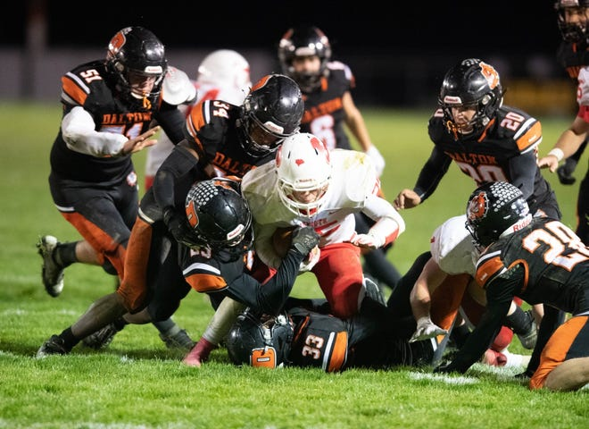 Dalton defenders swallow Plymouth running back Shea Sparks. The 'Dawgs defense suffocated the Big Red, pitching a shutout.