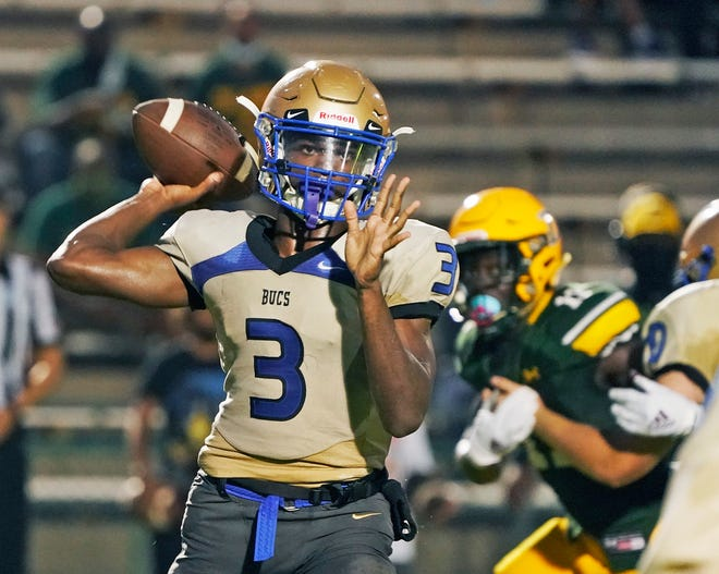 TJ Lockley (3) and Mainland claimed the No. 1 spot in The News-Journal's high school football power rankings with a 14-6 win at DeLand.