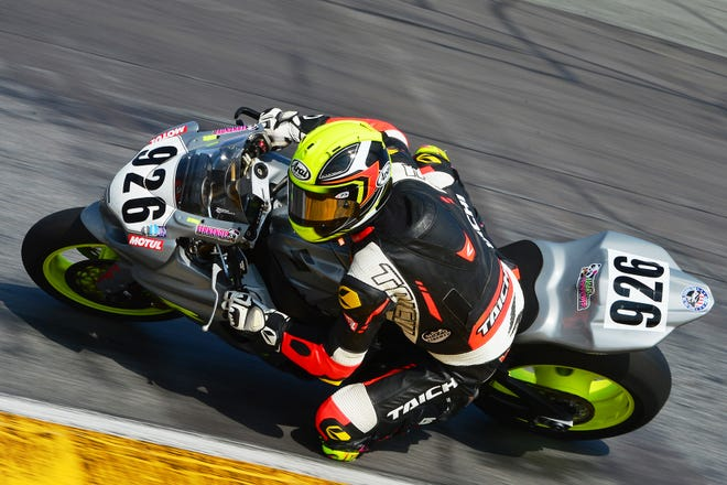Cory West races his Suzuki through the Daytona road course during Saturday's Race of Champions Challenge.