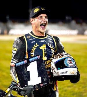 James Rispoli celebrates after winning AFT Production Twins championship at Daytona Friday night.
