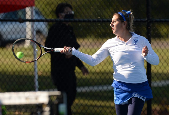 Villa Maria's Tara Thomas competes against Grove City's Mary Coulter in the District 10 Class 2A girls tennis tournament Saturday at the Villa Maria Academy tennis courts.