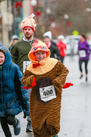 Ian Britt from Dawson, Maine was visiting family in the Southern Tier for the holiday and decided to dress up as a turkey and gobble gobble at the 2019 YMCA Turkey Trot. This year's event will be virtual.
