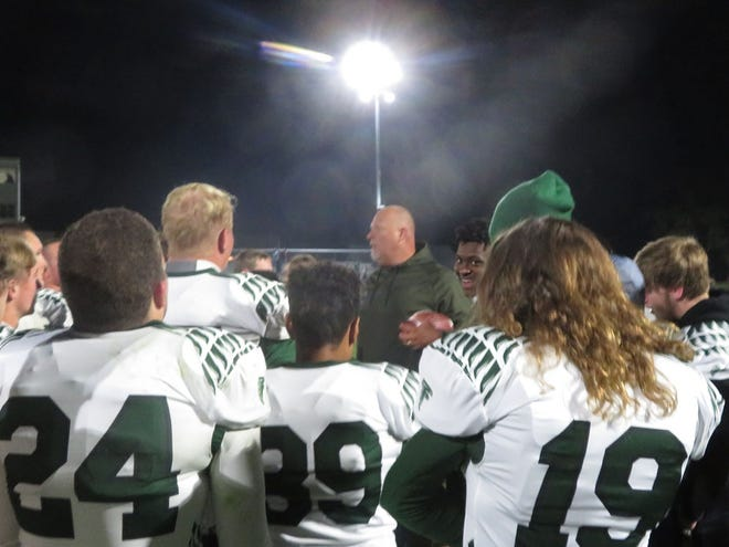 West Burlington-Notre Dame football coach Jay Eilers addresses his team after the Falcons' 30-24 victory over Davis County in a Class 2A playoff game Friday at Bloomfield.