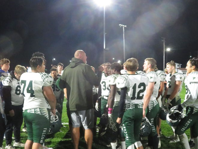 West Burlington-Notre Dame football coach Jay Eilers talks to his team after the Falcons' 30-24 victory over Davis County in a Class 2A playoff game Friday at Bloomfield.