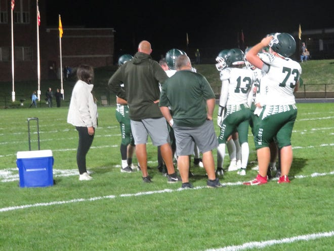 West Burlington-Notre Dame football coach Jay Eilers talks to his players during a timeout in Friday's 30-24 victory over Davis County at Bloomfield.