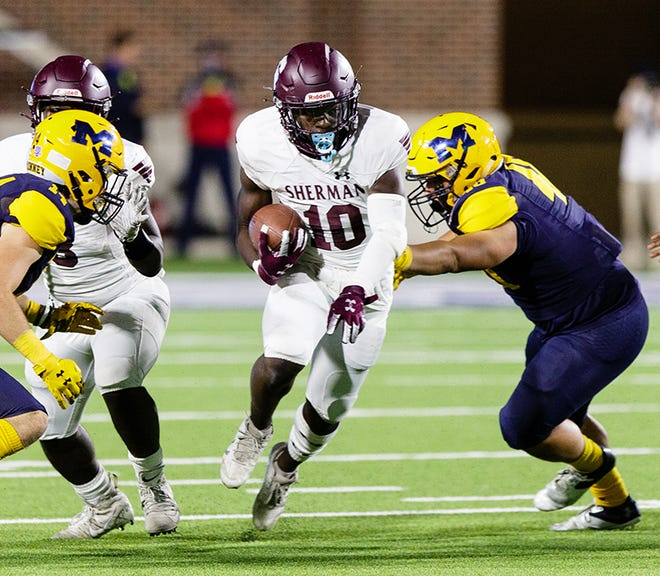 Sherman's Benji Omayebu tries to avoid a pair of McKinney defenders during non-district action.