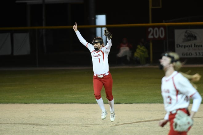 La Plata shortstop Brooklyn Carvajal jumps in the air after the final out of the Bulldogs' 6-0 win against Brashear.