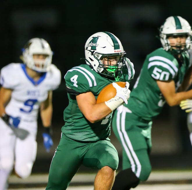 Aurora running back Evan McVay looks for running room during the Greenmen's 41-24 home playoff win Oct. 16 over Notre Dame-Cathedral Latin.