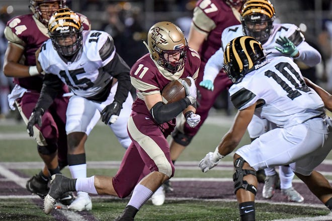 Stow-Munroe Falls running back Jack Bryden runs through the Cleveland Heights defense during Stow's opening playoff game. Bryden ran for 91 yards and a touchdown in Stow's 31-14 playoff loss at Mentor Oct. 16.