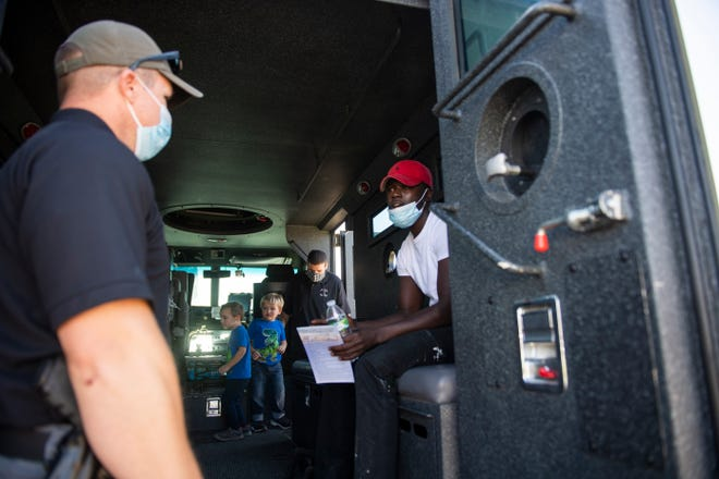 People tour a Lubbock Police Department SWAT vehicle at the 5-5-5 Move Over Slow Down rally on Saturday, Oct. 17, 2020, at Leroy Elmore Park in Lubbock, Texas.