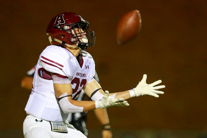 Abernathy's Sean Rodriguez (22) bobbles then catches a pass for a touchdown against Idalou during a District 4-3A Division II game Friday at Reddell Field in Idalou.