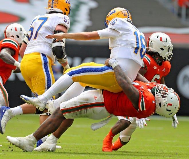 Miami defensive tackle Nesta Jade Silvera (1) tackles Pittsburgh quarterback Joey Yellen (16) in the second quarter on Saturday in Miami Gardens.