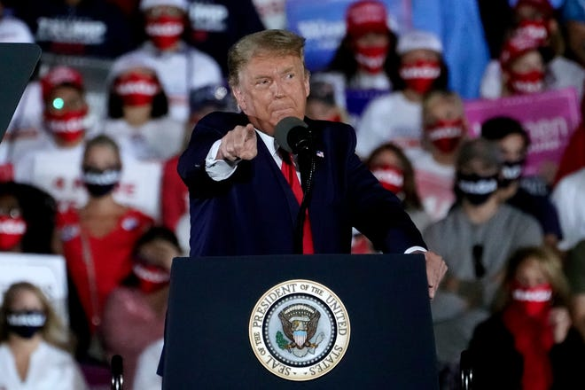 President Donald Trump speaks during a campaign rally at Middle Georgia Regional Airport on Friday in Macon, Ga.