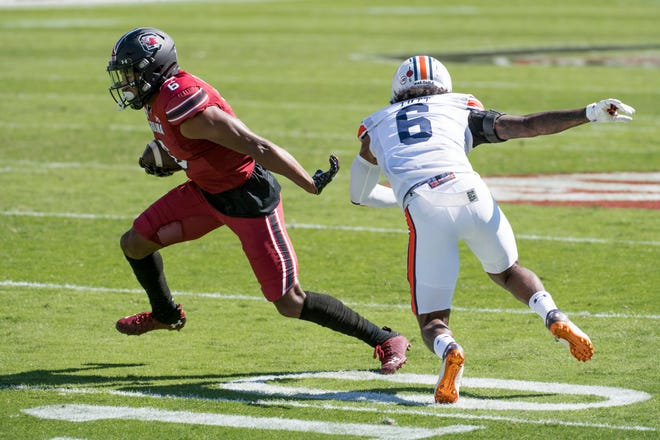 South Carolina wide receiver Josh Vann (6) runs with the ball against Auburn defensive back Christian Tutt (6) during the first half on Saturday in Columbia, S.C.