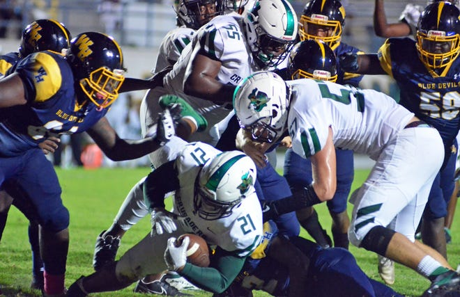 Tampa Catholic junior running  back KJ Covington bores into the end zone on a 3-yard touchdown run in the second quarter against Winter Haven to take a 13-0 lead on Friday at Denison Stadium in Winter Haven.