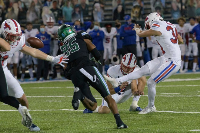 SMU placekicker Chris Naggar (34) kicks the winning field goal in overtime to give his team a victory over Tulane in New Orleans on Friday.