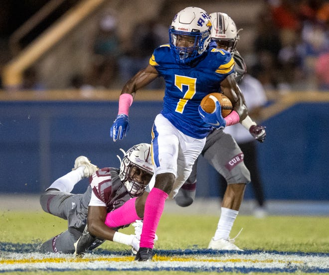 Auburndale running back Nate Garnett is tackled by Madison County defender Jay West on Friday night at Bruce Canova Stadium in Auburndale.
