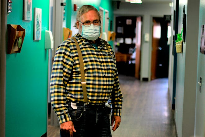 Dr. Tom Dean poses at his clinic in Wessington Springs, S.D., on Friday. Dean is one of three doctors in the county, which has seen one of the nation's highest rates of coronavirus cases per person. He writes a column in the local newspaper, the True Dakotan, urging people to take precautions against the virus.