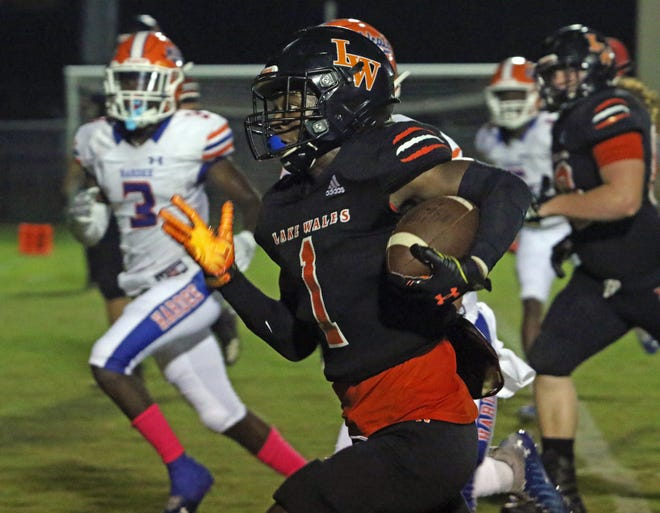 Lake Wales running back Merari McCullough runs for a touchdown after catching a screen pass against Hardee in the first quarter on Friday night at Legion Field.