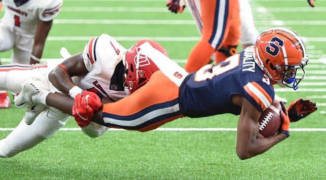 Syracuse wide receiver Taj Harris (3) is tackled after a reception against Liberty during the first half Saturday  at the Carrier Dome. Liberty won 38-21, dropping Syracuse to 1-4 overall.