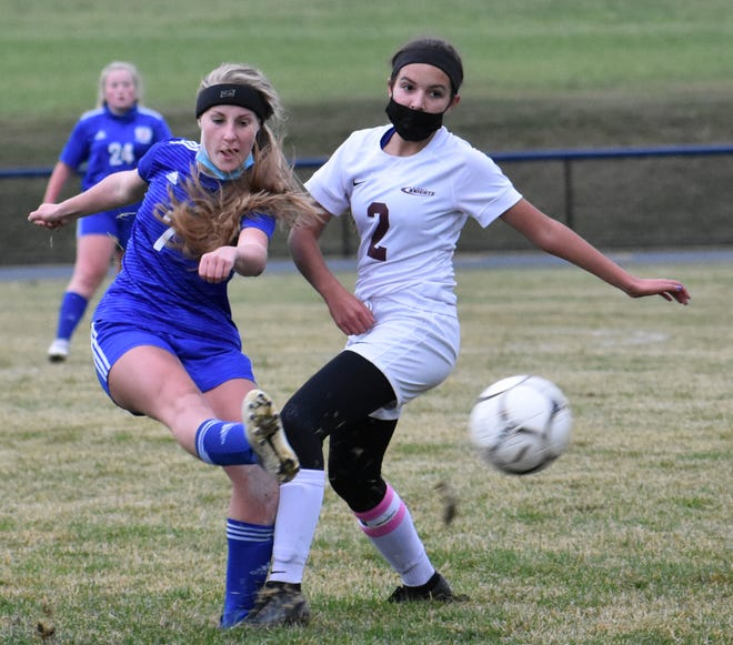 Poland junior Lexi Bates (left)  fires a shot past Frankfort-Schuyler's Megan Munch during the Tornadoes' 4-0 win over the Maroon Knights Friday, Oct. 16, 2020, in Poland.