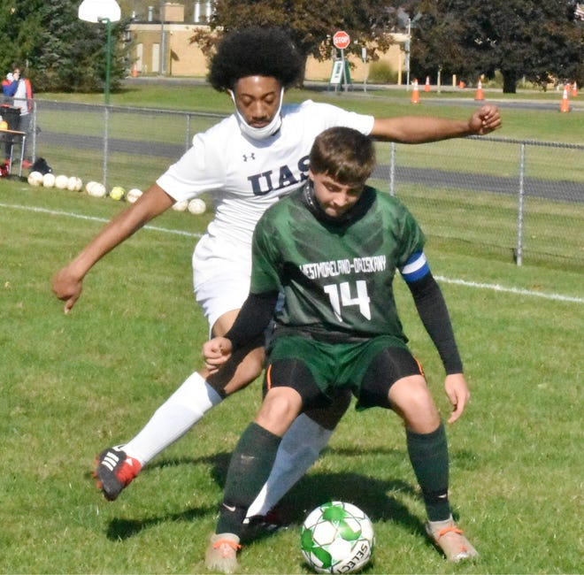 Westmoreland-Oriskany's Johann Bratge tries to keep the ball from Utica Academy of Science's Jaiovanni Bowman during a game Saturday, Oct. 17 at Westmoreland High School. Westmoreland-Oriskany won the game 3-0 to improve to 5-1-0 this season.
