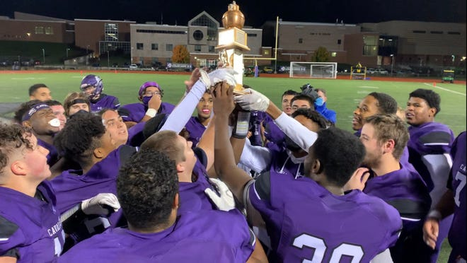 The East Stroudsburg South football team celebrate winning the 76th annual Little Brown Jug game over Stroudsburg 69-7 on Friday, Oct. 16, 2020.