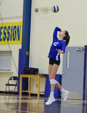 Abby Toeniskoetter, pictured launching a serve in Friday night's first set, led Lake Worth Christian with nine kills in the match.