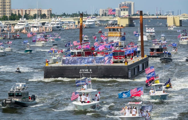 A group of boats in support of President Donald Trump makeis way way down the Intracoastal Waterway through West Palm Beach on Saturday toward Mar-a-Lago.