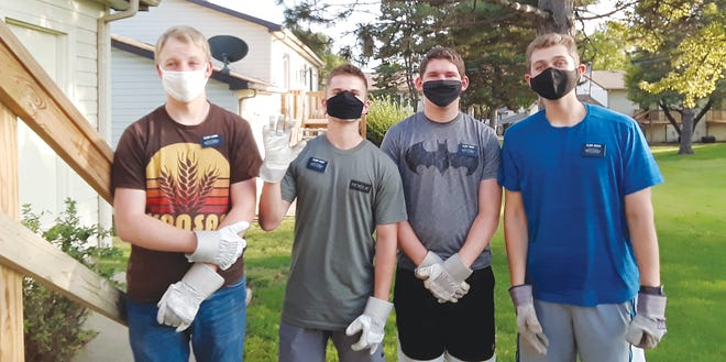 Volunteer missionaries serving in Pratt with The Church of Jesus Christ of Latter-Day Saints include (from left) Elder Dustin Loomis, Elder Davis Tovey, Elder Chase Tingen and Elder Devin Weeks. They are from Utah and have been helpling with lawn care, heavy lifting or family history research.