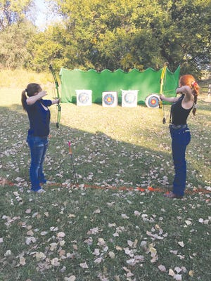 Justice Fanning (left) and Abigail Kendall, both Pratt HIgh School juniors get in some target practice at the KDWPT headquarters east of Pratt.