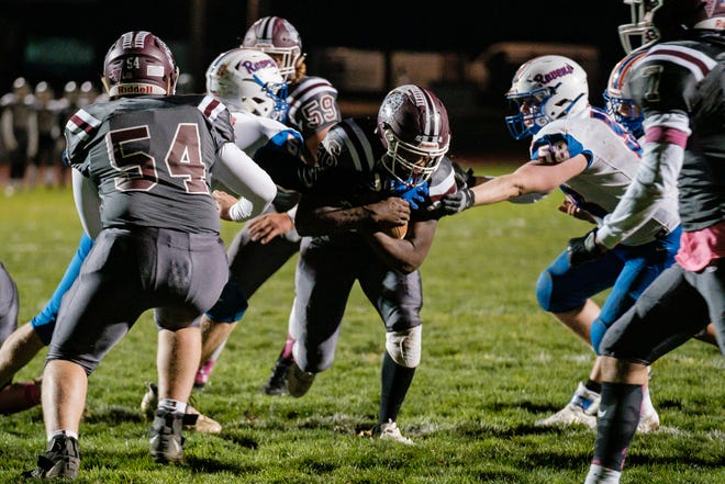 Woodridge running back Dayshard Garr-Stafford makes a run up the middle for a touchdown against Ravenna Friday, October 16, 2020 in Peninsula.