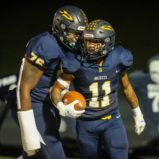 Streetsboro seniors Richtell McCallister and Michael Hall Jr. celebrate in the end zone after a rushing TD from McCallister during Friday night's Division III playoff game against the Niles McKinley Red Dragons at Streetsboro High School. [Nick McLaughlin, Special to The Record-Courier]