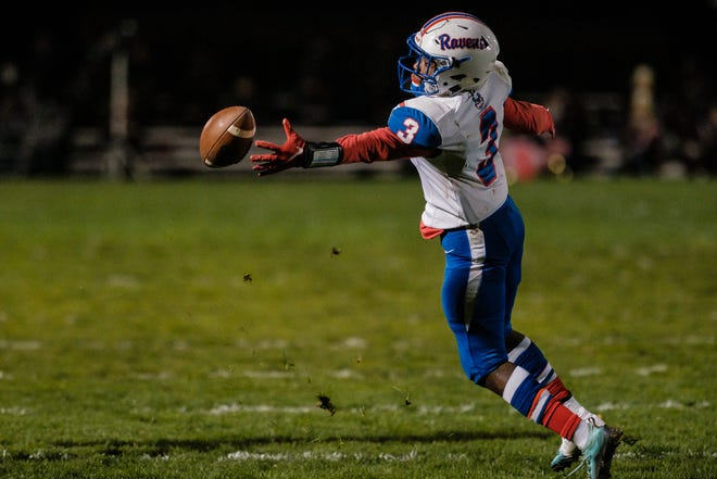 Ravenna wide receiver Domo Allah can't quite get a grip on a pass against Woodridge Friday, October 16, 2020 in Peninsula.