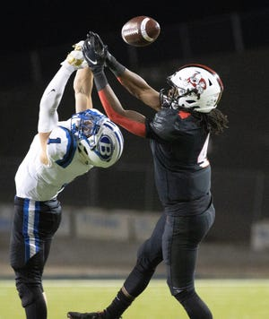 A pass intended for McKinley's Jonah Lytle is broken up by Brunswick's David Hamrick on Friday, Oct. 16, 2020. (Special to The Canton Repository / Bob Rossiter)