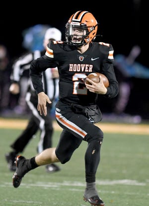 Hoover's Connor Ashby runs for a gain in the second quarter of Lake at Hoover football.  Friday, October 16, 2020.