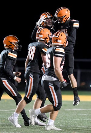 Hoover's Owen Blackledge (background, facing camera) celebrates with teammates during the Vikings' 48-29 win against Lake at Memorial Stadium. Oct. 16, 2020.