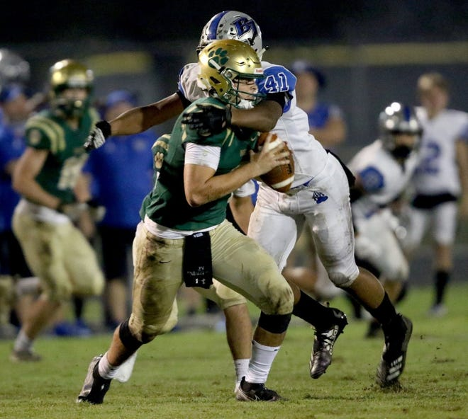 Bartram Trail safety Micah Pollard (41) sacks Nease quarterback Will Carn near the end of the second quarter Friday.