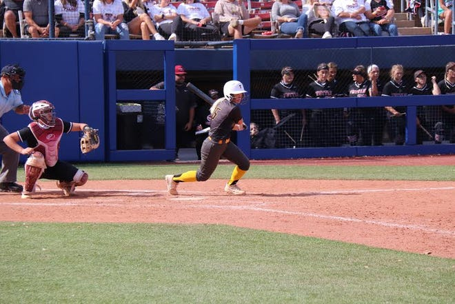 Tecumseh's Lauren Taylor singles in the third inning Friday in the Class 4A State Fastpitch Softball Tournament at Hall of Fame Stadium.