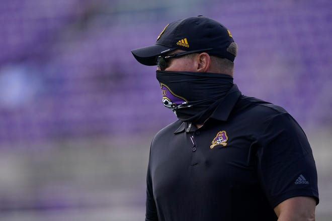 East Carolina head coach Mike Houston looks on from the sidelines during the half of an NCAA college football game against Central Florida in Greenville, N.C., Saturday, Sept. 26, 2020. (AP Photo/Gerry Broome)