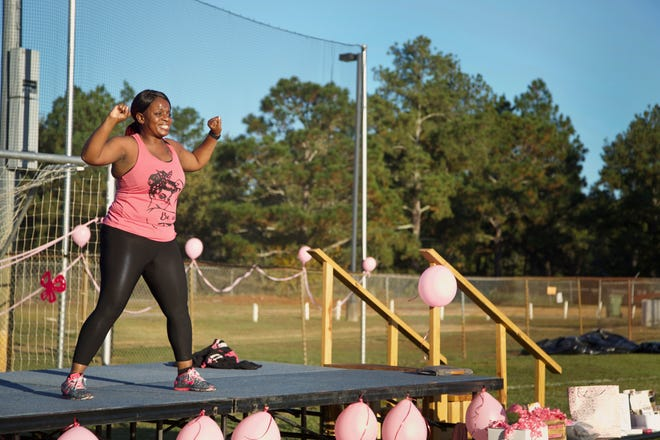 Ruby Murray leads a Turn the Park All Colors of Cancer fitness class at Hope Mills Park on Saturday.