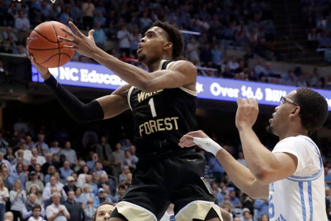 Wake Forest's Isaiah Mucius drives to the basket against North Carolina's Garrison Brooks in a game last season. Mucius is the leading returning scorer for the Demon Deacons.
