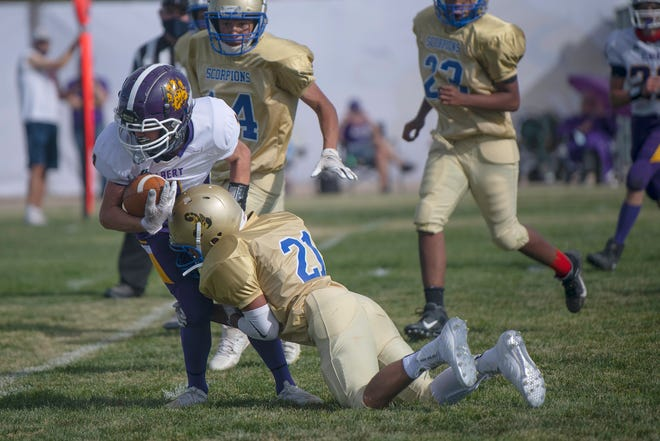 Dolores Huerta's Andres Rubio makes a tackle during the Scorpion's match-up with Elbert on Saturday, October 17, 2020.
