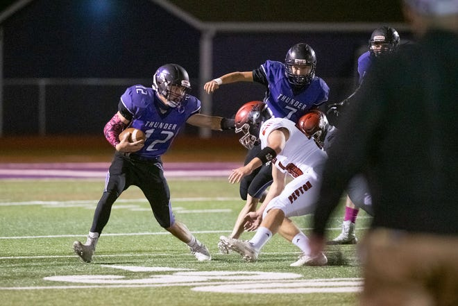 Rye High School's Daniel Indgjer, left, runs to the outside away from Peyton defenders during the Thunderbolts' first home game of the season on Friday. [CHIEFTAIN PHOTO/ZACHARY ALLEN]
