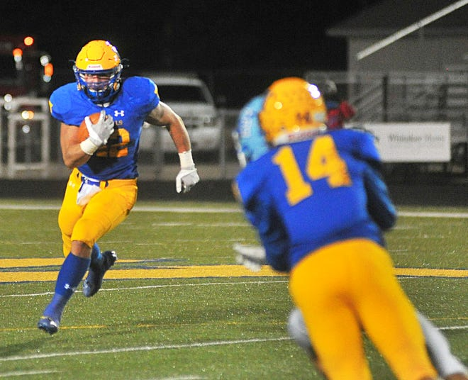 Joey Lyons looks for yardage during Wooster's playoff loss to Olentangy Berlin. Since Wooster's postseason game, Lyons has exploded for 499 yards and nine TDs in two games.