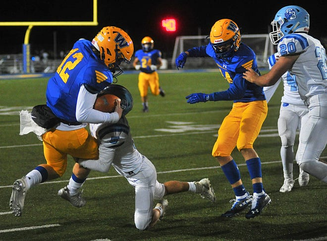 Wooster's Owen Roach gets pushed out of bounds by Olentangy Berlin's Connor Gavin (5)