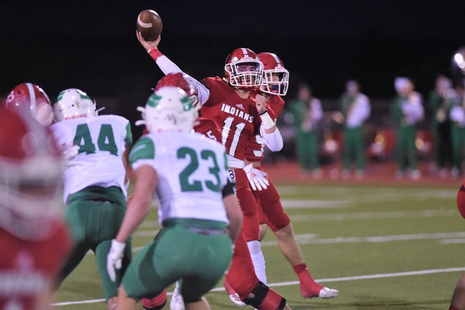 Jim Ned quarterback Tate Yardley (11) fires a pass during Friday's game against Wall at Indian Stadium in Tuscola on Oct. 16. The Indians won the top-10 matchup, 28-8.